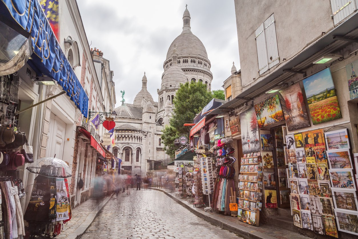 a view along streets in montmartre paris during the day - Paris Must See